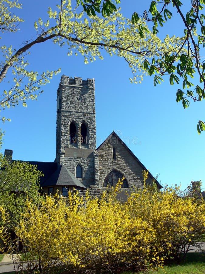Church: yellow spring flowers stock photo