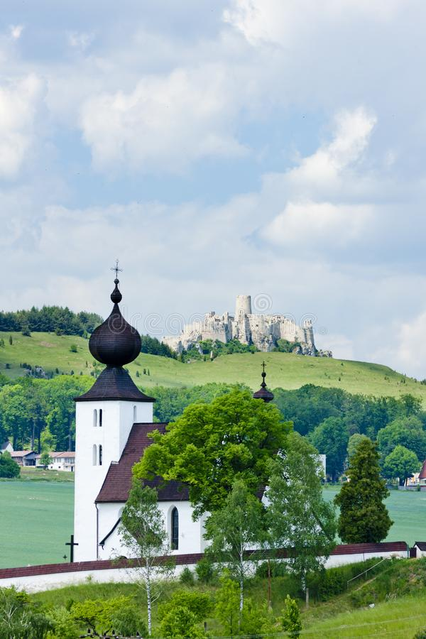 Church in Zehra and Spissky Castle at background, Slovakia. Outdoors, outside, exteriors, europe, eastern, republic, czechoslovakia, hrad, architecture royalty free stock photo