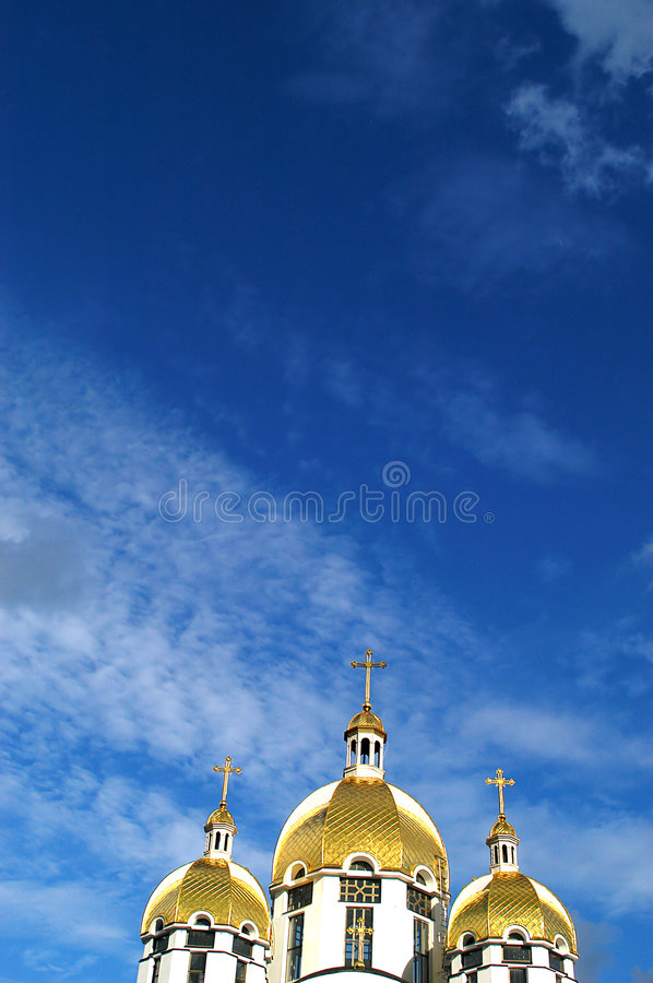 Churches. An image of a churches on a background of clouds royalty free stock photo