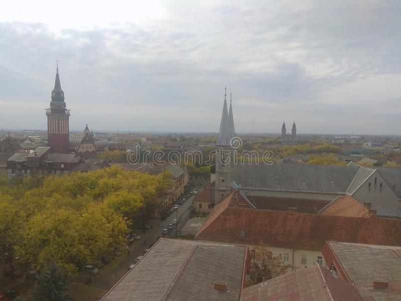 Churches and bells. Catholic churches and City house, and his towers in the morning, in Pannonian city of Subotica, panorama royalty free stock photography