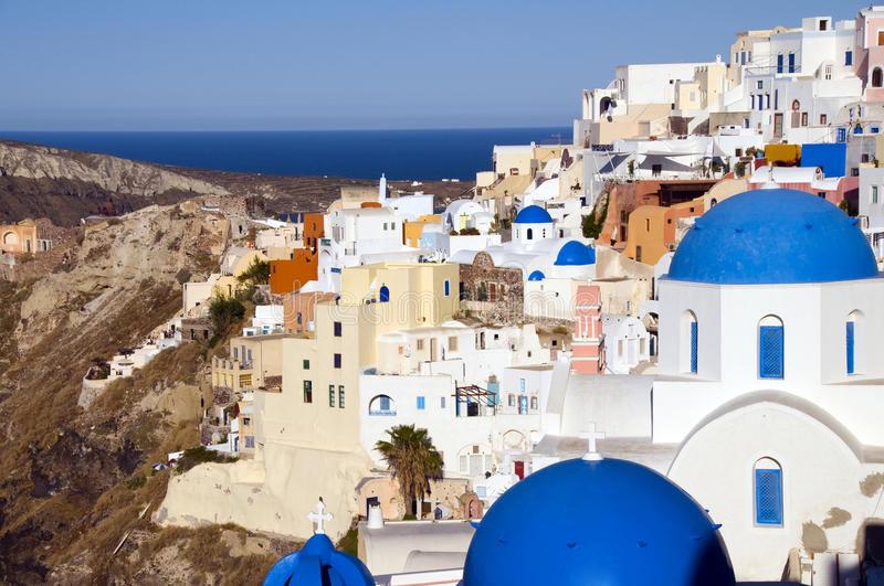 Churches cyclades architecture oia santorini gr. Blue dome churches and classic cyclades architecture over the mediterranean sea in oia santorini the famous royalty free stock photography
