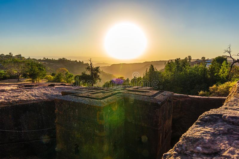 Sunset at monolithic church of Saint George Bet Giyorgis. The churches of Lalibela is on UNESCO World Heritage List stock photography