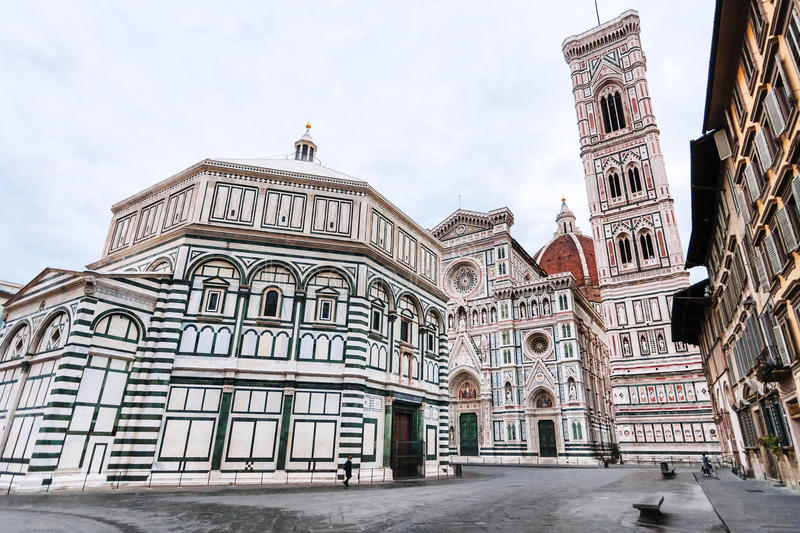 Churches on Piazza San Giovanni in morning. Travel to Italy - view of Piazza San Giovanni with Baptistery Battistero di San Giovanni, Baptistery of Saint John stock images