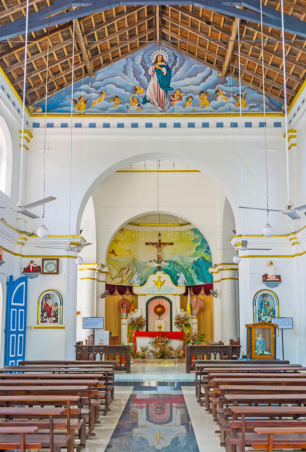 The Churches in Sri Lanka. PUTTALAM, SRI LANKA - NOVEMBER 25, 2016: The prayer hall of St Mary Church with light walls and bright paintings, on November 25 in stock photos