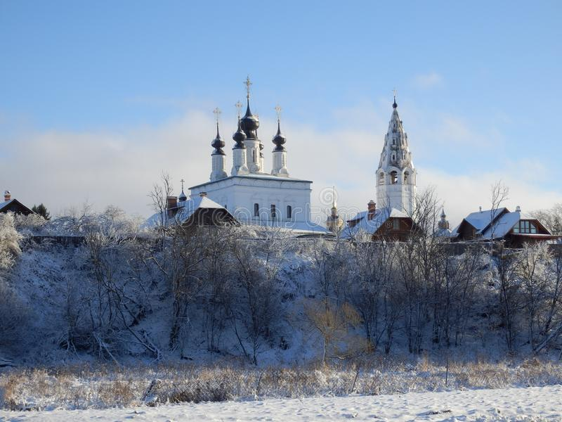 Churches in Suzdal in winter. White Churches in Suzdal in winter. Blue Sky and snow. Golden ring near moscow, Russia stock images