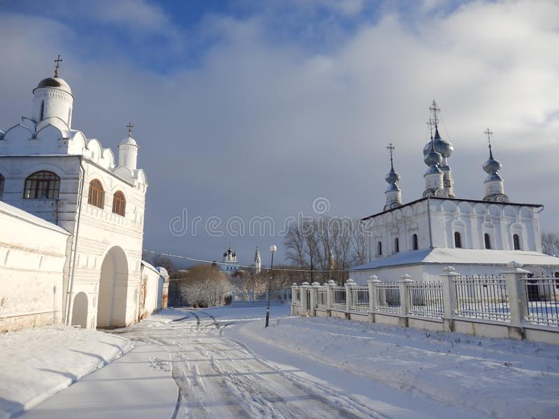 Churches in Suzdal in winter. White Churches in Suzdal in winter. Cloudy Sky and snow. Golden ring near moscow, Russia stock photography