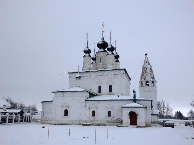 Churches in Suzdal in winter. White Churches in Suzdal in winter. Cloudy Sky and snow. Golden ring near moscow, Russia royalty free stock photo