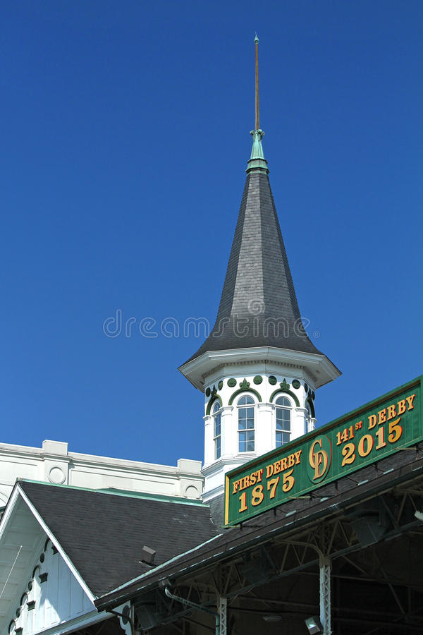 Churchill Downs racetrack steeple and sign. Louisville, KY, USA - June 21, 2015: Close up of the Churchill Downs steeple and sign. against a clear blue sky stock image