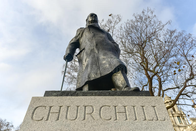 Churchill - Houses of Parliament - London. Statue of Sir Winston Churchill in Parliament Square Garden in London royalty free stock photos