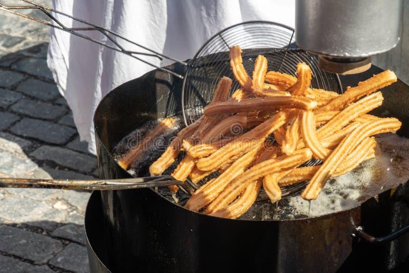 Churreria cooking churros on street market royalty free stock photos