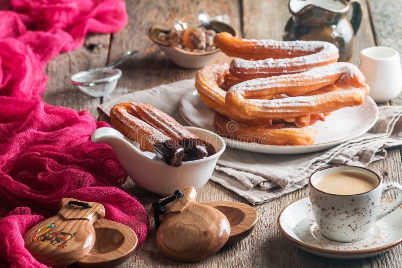 Churros, café e chocolate quente imagem de stock royalty free