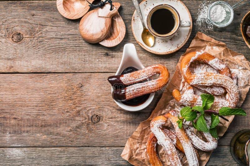 Churros, café e chocolate quente fotografia de stock royalty free