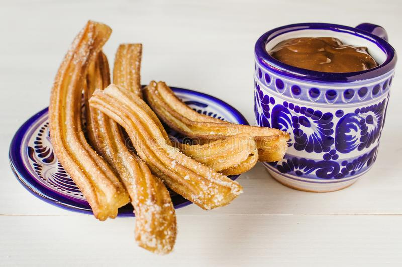 Churros con Chocolate in Puebla Mexico. Churros con Chocolate, porras white background sweet pastry sugar puebla mexico royalty free stock photography