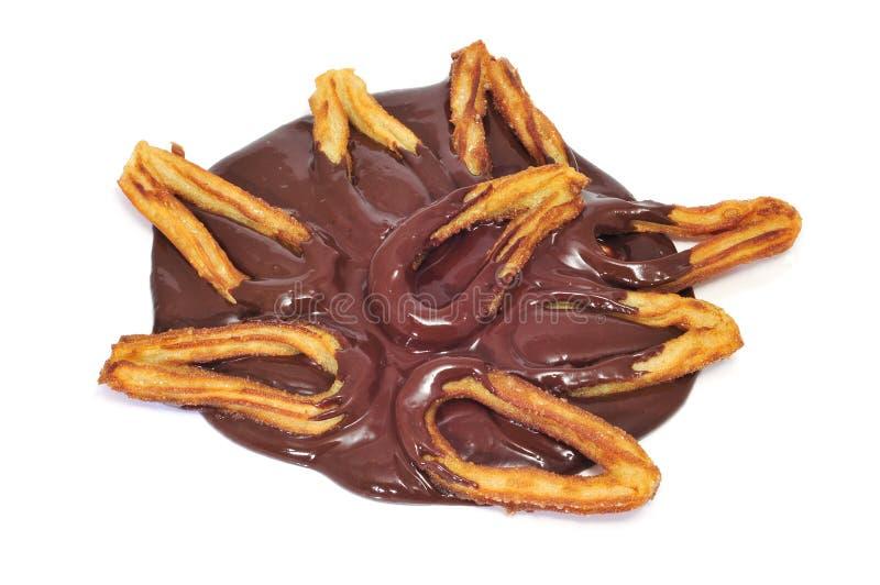 Churros con el chocolate imagen de archivo