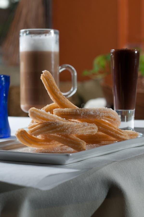 Churros with a dark chocolate sauce stock image