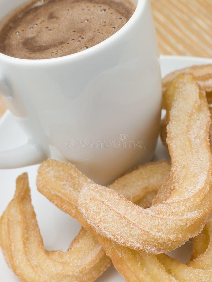 Churros e cioccolato caldo fotografia stock libera da diritti