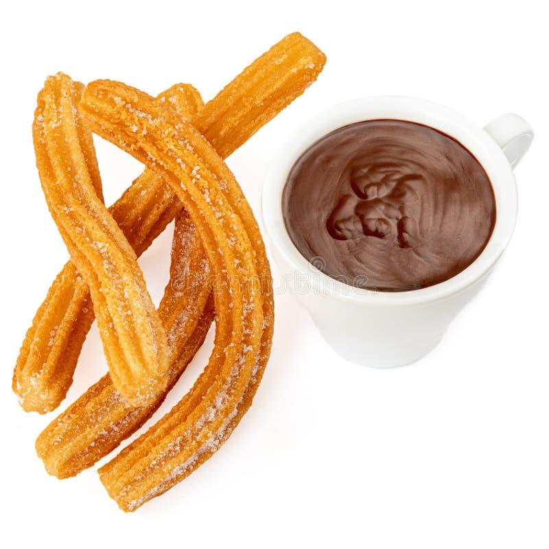 Churros med chokladkoppen Churro - stekt degbakelse med sockerpulver som isoleras på vit bakgrund arkivfoton