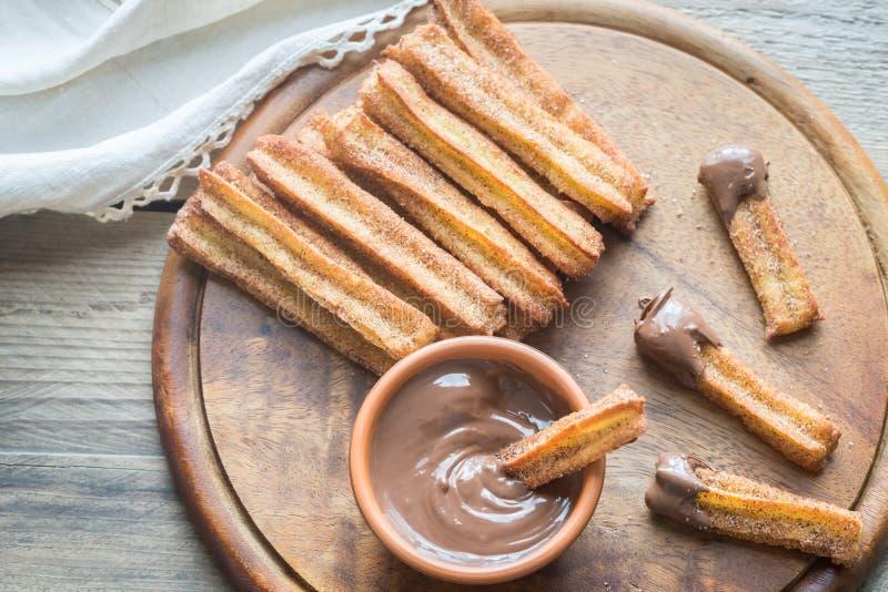 Churros - sławny Hiszpański deser z czekoladowym kumberlandem zdjęcie stock