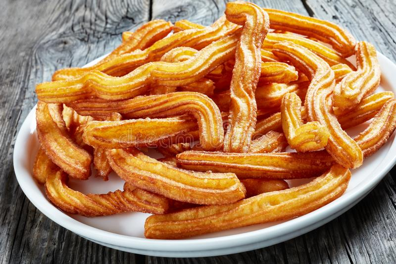 Churros - Traditional Spanish dessert on a plate stock photos