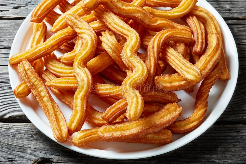 Churros - Traditional Spanish dessert on a plate royalty free stock photography