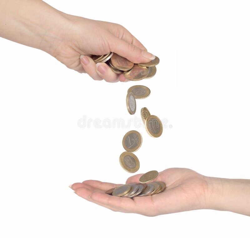 Chute de pièces de monnaie de corps à corps photo stock