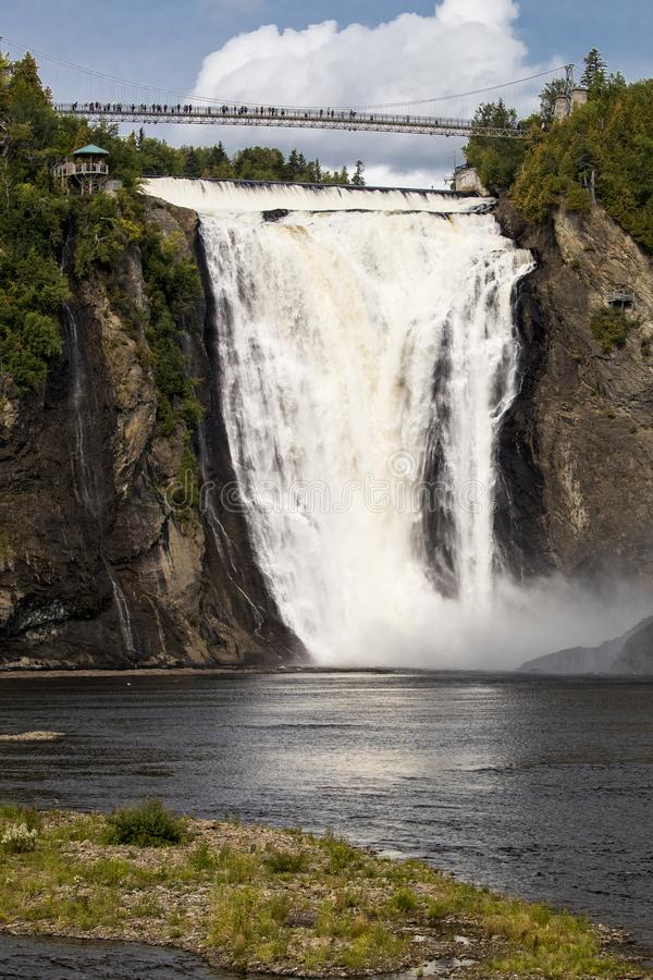 Chute Montmorency falls near Quebec City. Chute Montmorency waterfalls near Quebec City in vertical picture stock photo