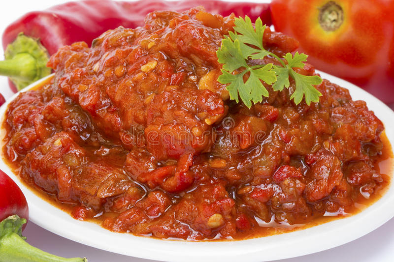 Chutney of tomatoes with peppers. Lutenica - traditional pepper and tomato relish from the Balkans royalty free stock photo