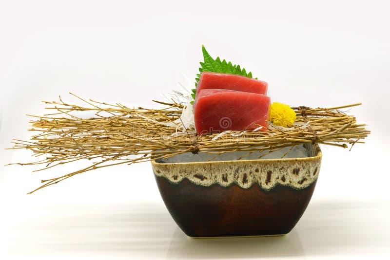 Chutoro (Tuna) sashimi in brown bowl Japanese style on white background royalty free stock photography