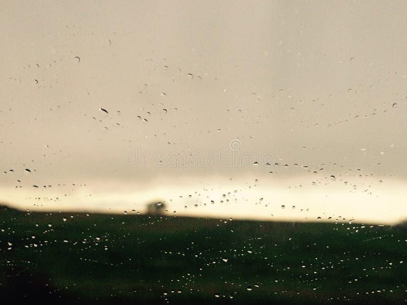 Chuva no sol imagem de stock