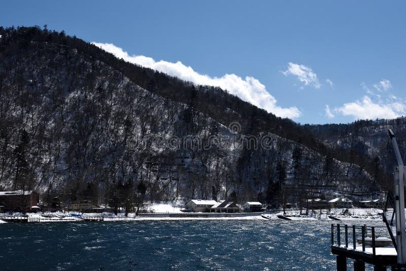 Chuzenji lake. Snow covered over Chuzenji lake and mountainous areas. This picture was taken at Chuzenji lake , Nikko , Japan royalty free stock image