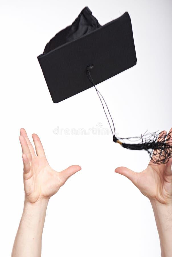 Chwytający skalowanie kapelusz w powietrzu obraz stock