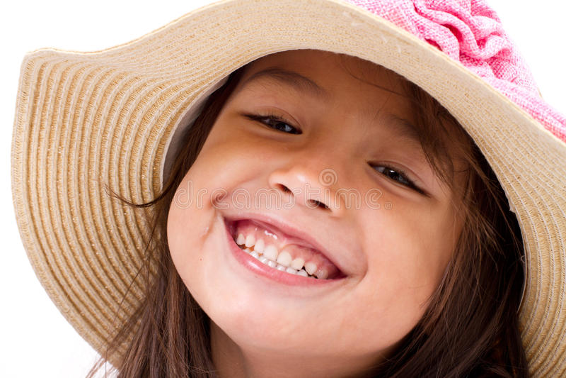 Ciérrese encima de cara del niño caucásico asiático femenino feliz, sonriente imagenes de archivo