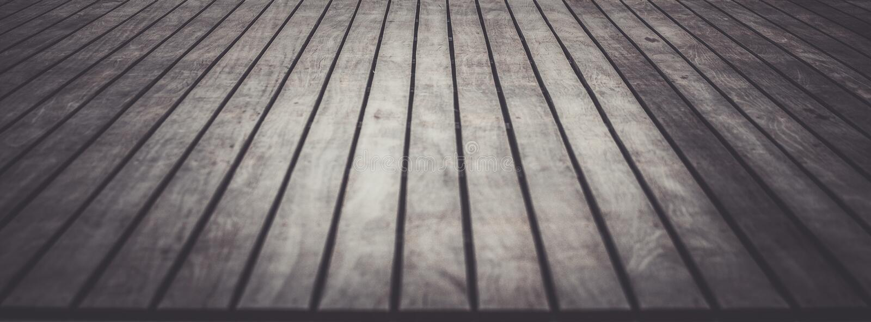 Ciérrese encima de decking y del suelo de madera foto de archivo
