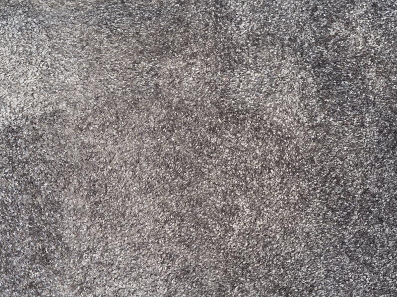 Ciérrese encima de fondo gris apacible de la textura de la alfombra imágenes de archivo libres de regalías