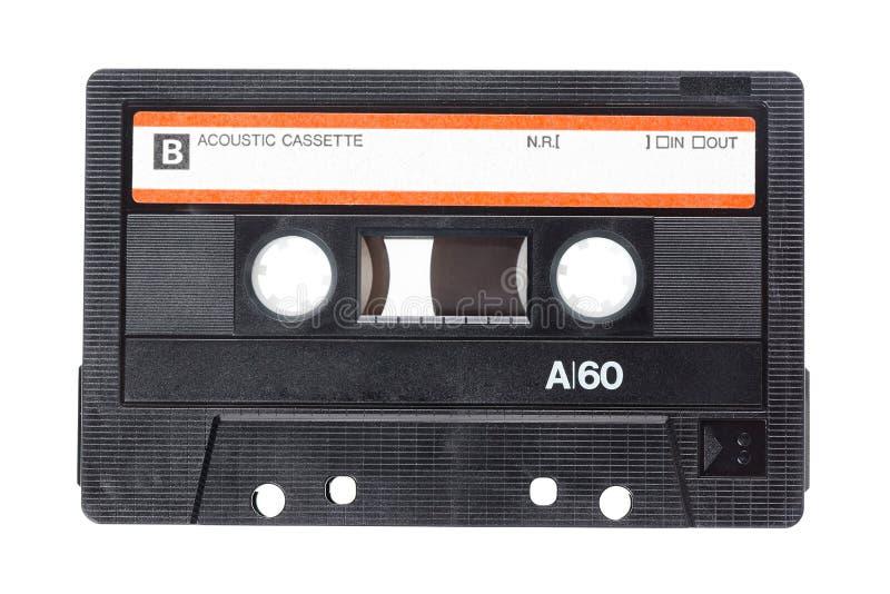 Ciérrese encima de imagen de una cinta de casete audio del vintage aislada en el fondo blanco Visión superior imagen de archivo