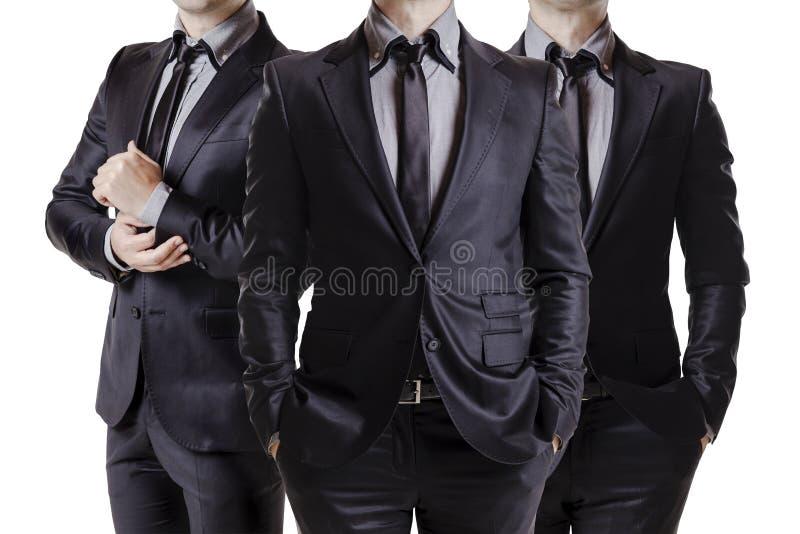 Ciérrese encima de la imagen de los hombres de negocios en traje negro fotos de archivo libres de regalías