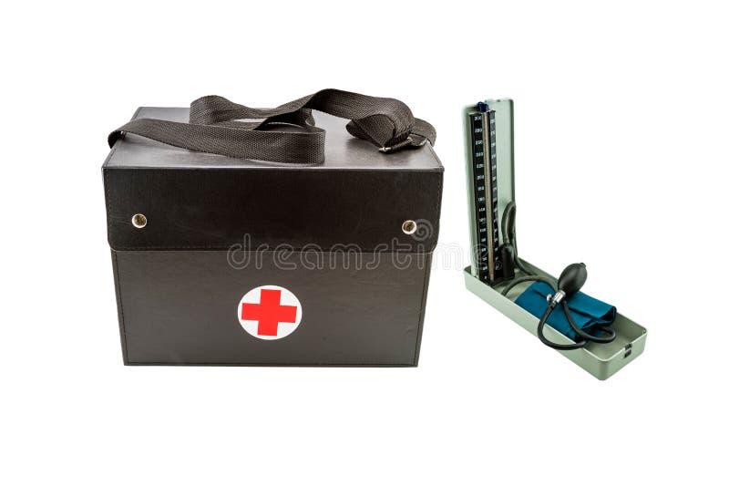 Ciérrese encima de la llamada casera, del bolso del ` s del doctor y de los manómetros de la herramienta del monitor de la presió fotografía de archivo