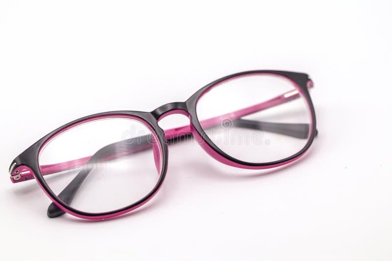 Ciérrese encima de los vidrios negros y rosados del ojo en el fondo blanco fotos de archivo libres de regalías