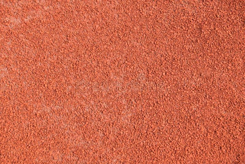 Ciérrese encima de pista del atletismo en el estadio del deporte para la textura y el fondo fotos de archivo libres de regalías