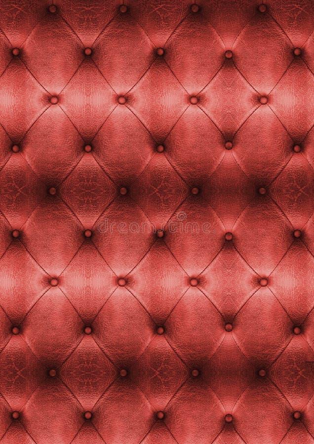 Ciérrese encima de textura roja del cuero del sofá del vintage fotografía de archivo