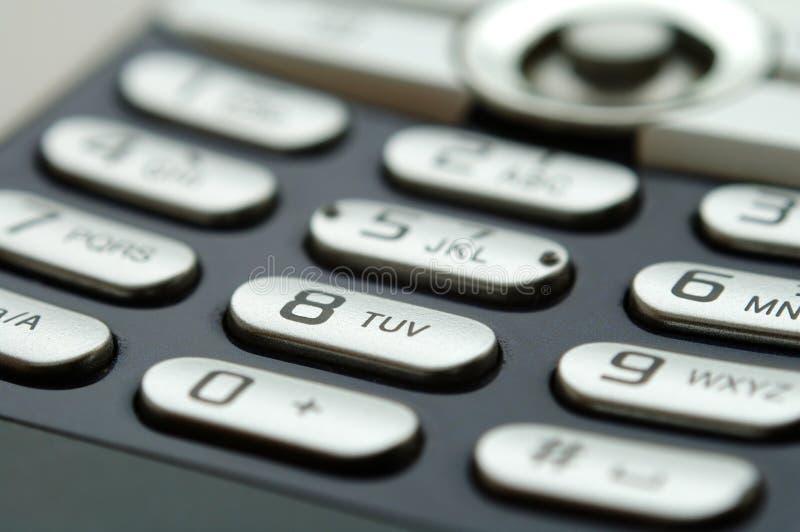 Ciérrese encima de tiro del telclado numérico móvil bajo luz imagenes de archivo
