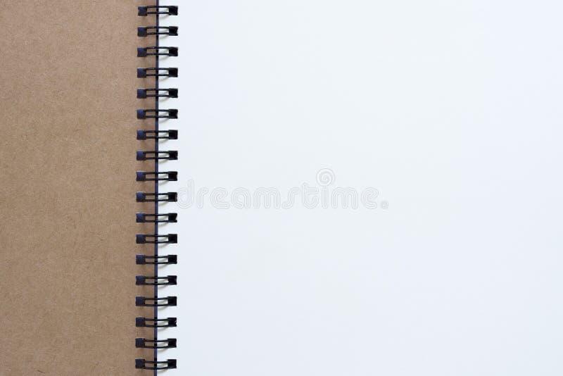 Ciérrese encima de tiro de la vista superior del papel reciclado espacio en blanco espiral cerrado fotografía de archivo libre de regalías