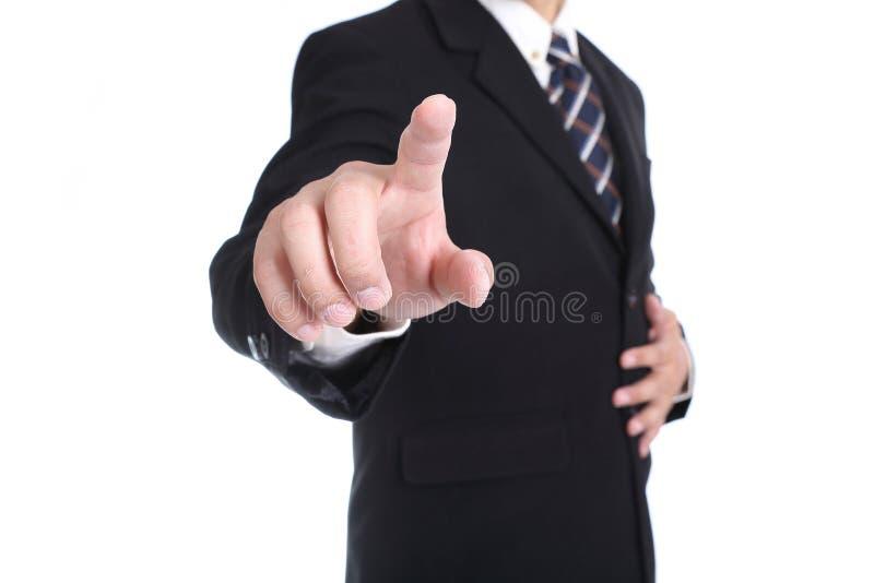 Ciérrese encima del botón conmovedor del hombre de negocios imagen de archivo