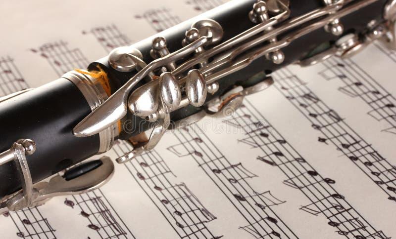 Ciérrese encima del detalle del clarinet y del cuaderno fotografía de archivo