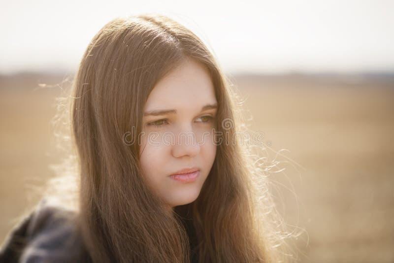 Ciérrese encima del retrato de la chica joven triste foto de archivo libre de regalías