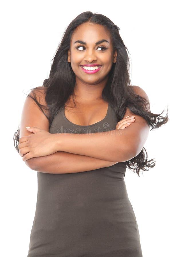Ciérrese encima del retrato de una sonrisa afroamericana linda de la muchacha foto de archivo