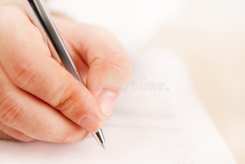 Ciérrese para arriba con una escritura de la mano imagen de archivo libre de regalías