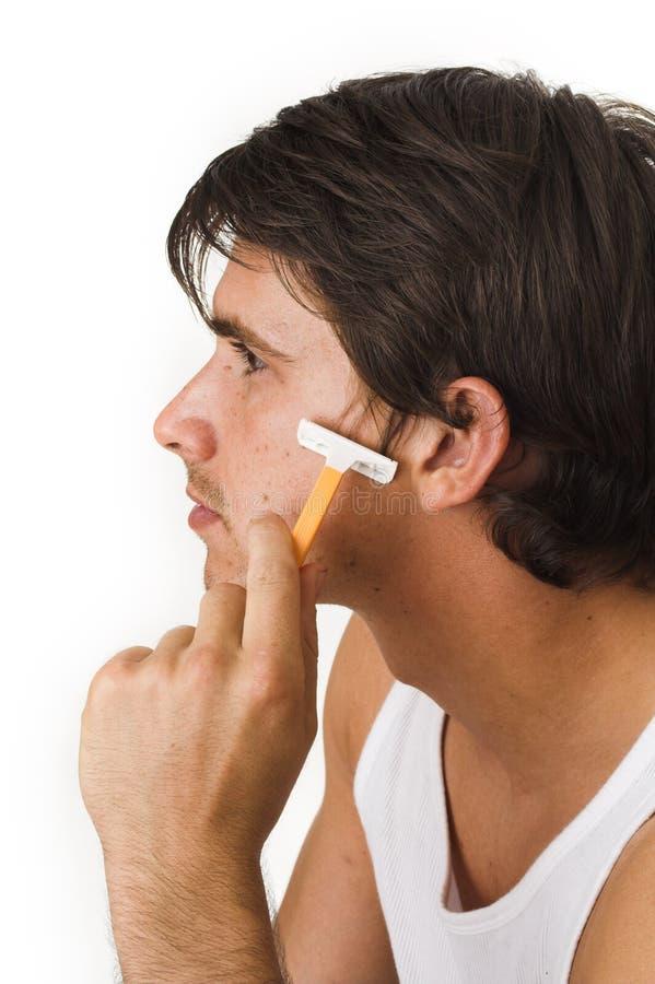 Ciérrese para arriba de afeitar del hombre joven fotos de archivo