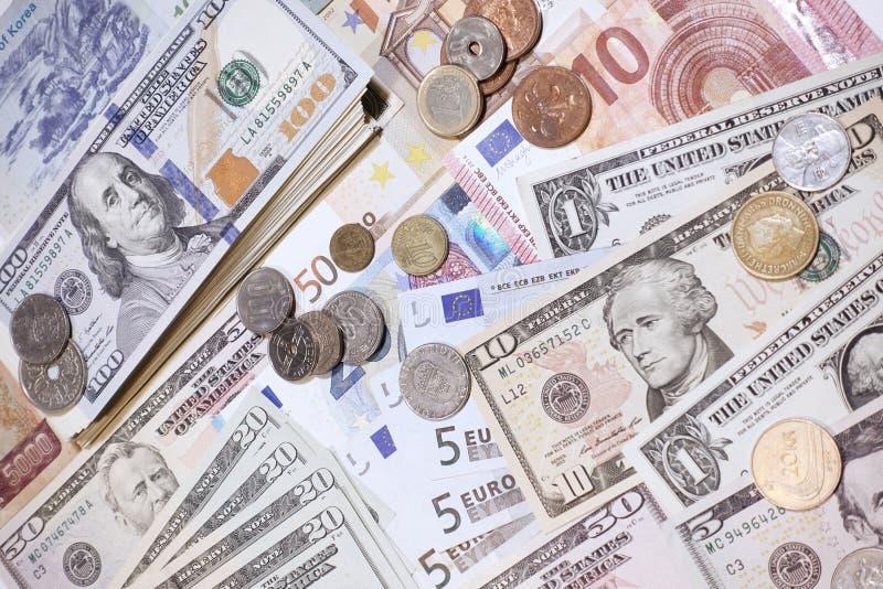 Ciérrese para arriba de billete de banco y de moneda imagen de archivo