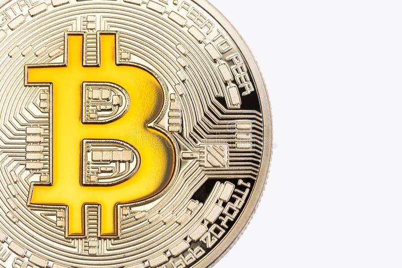 Ciérrese para arriba de bitcoin de oro en el fondo blanco fotografía de archivo